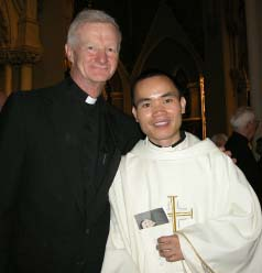 Former altar server comes home to serve: Rev. Huy H. Nguyen with Rev. Dan Finn, pastor of St. Mark's Parish. Nguyen was ordained on May 23 at the Cathedral of the Holy Cross. Photo by Patrick O'Connor